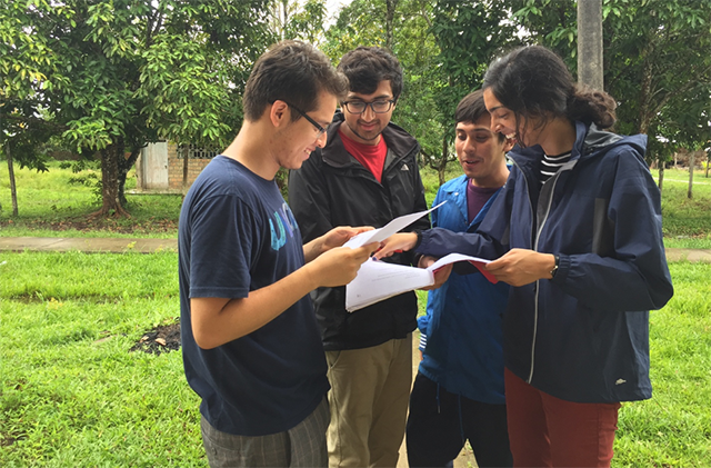 The UniDx team discusses details during the pilot study in the Manacamiri Village in the Peruvian Amazon. (Photo courtesy of Neil Davey)