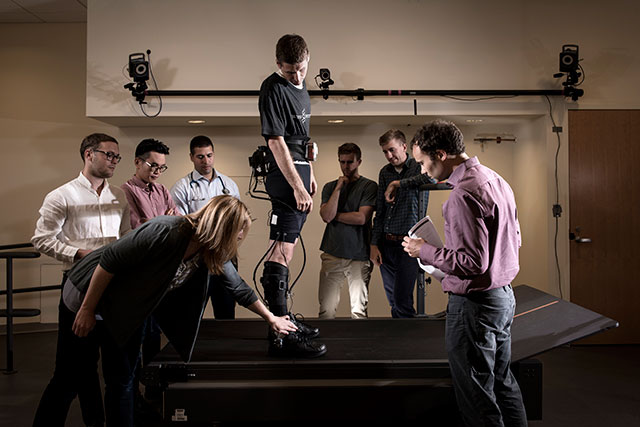 The multidisciplinary team of engineers, designers, biomechanists and physical therapist discussing progress on the exosuit. Credit: Rolex Awards/Fred Merz