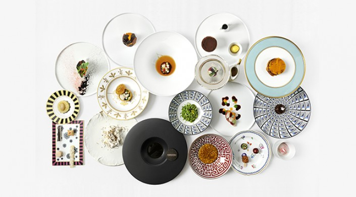 An arrangement of bowls and plates of varying sizes and designs.