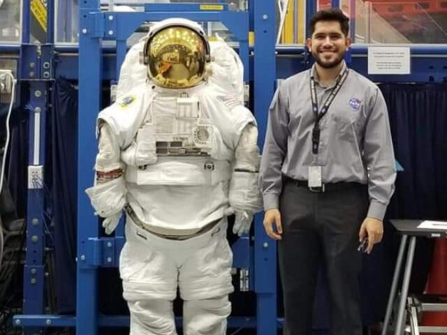 Juan Carlos Lopez with an EVA suit