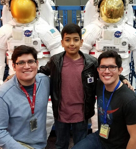 Juan Carlos López with his brother and nephew exploring NASA exhibits