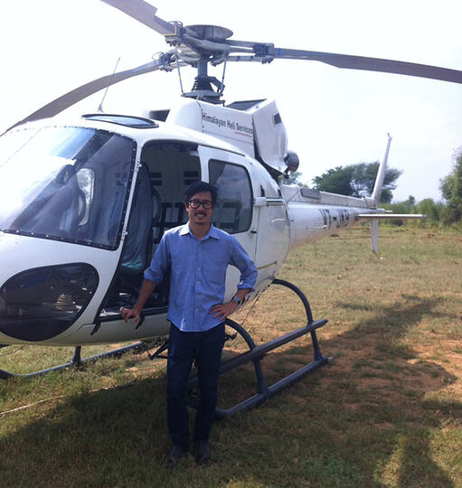 Winston Yu prepares to board a helicopter