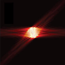 Light from an optical fiber illuminates the metasurface, is scattered in four different directions, and the intensities are measured by the four detectors.