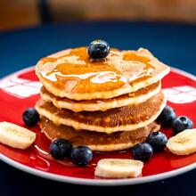 Photo of a stack of blueberry pancakes on a plate
