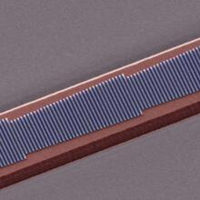 Image of a fabricated device showing four phased antenna arrays consisting of silicon nano-rods of different lengths patterned on the top surface of a LiNbO3 waveguide (Image courtesy of the Loncar Lab/Harvard SEAS)