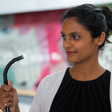 Steffi Sunny is pictured holding an endoscope.