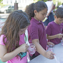 Second graders at the Gardner Pilot Academy in Boston's Allston neighborhood learned about materials science from students in the Research Experience for Undergraduates program at SEAS. (Photo by Adam Zewe/SEAS Communications)