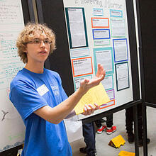 Theodore Woodward of Vassal Lane Upper School presents his science project on an echolocation vest for the blind