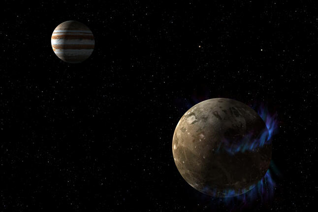 An illustration of the moon Ganymede orbiting Jupiter.