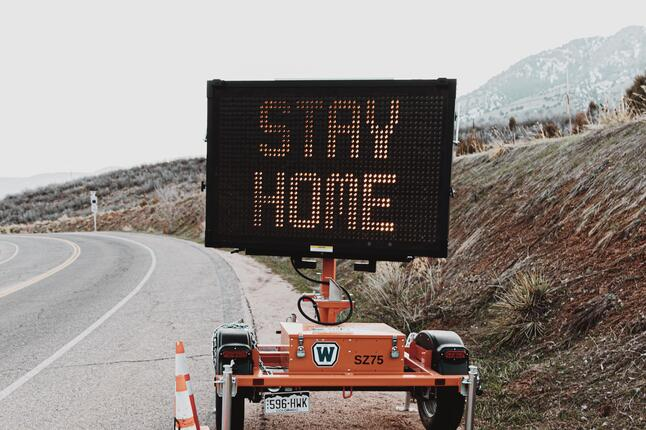 picture of a stay at home sign
