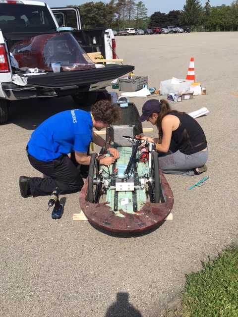 Mechanical engineering concentrator Joe Pappas, S.B. '17, and applied math concentrator Daphne Kaxiras, A.B. '21, make final adjustments to the SEAS Racing Team car before entering the first round of technical inspections. (Photo courtesy of Joe Pappas)