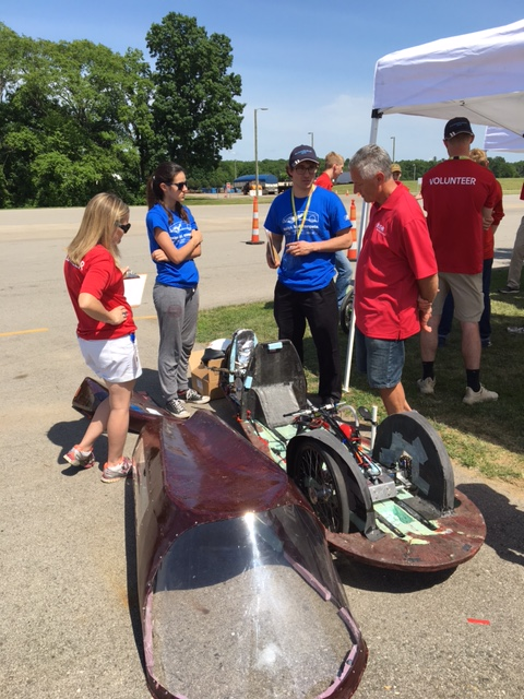 Pappas and Kaxiras offer an oral presentation about their car to the SAE Supermileage Competition judges. (Photo courtesy of Joe Pappas)