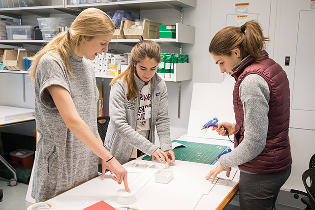 Teammates Mollie Breen, Valentina Villagra, and Emily Gould collaborate to createa a rapid prototype. (Photo by Eliza Grinnell/SEAS Communications)