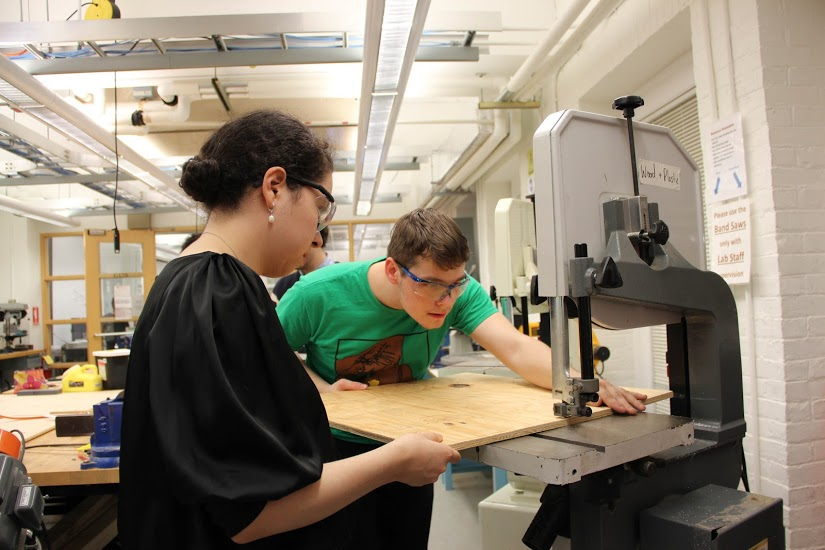 Julie Ortiz, S.B. '19, a mechanical engineering concentrator, and Timothy Tamm, A.B. '18, a computer science concentrator, cut a sheet of plywood down to size for a MicroMouse test maze. (Photo provided by HURC.)