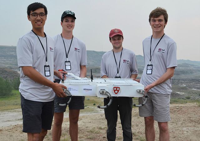 Harvard Undergraduate Robotics Club Mars Rover team members (from left) Albert Chien, S.B. '19, a mechanical engineering concentrator, Alex Wulff, S.B. '21, an electrical engineering concentrator, Robert Anderson, S.B. '19, a mechanical engineering concentrator, and Matthew Giles, S.B. '21 piloted their six-legged rover through numerous challenges in the Canadian International Rover Challenge. (Photo courtesy of the Harvard Undergraduate Robotics Club)