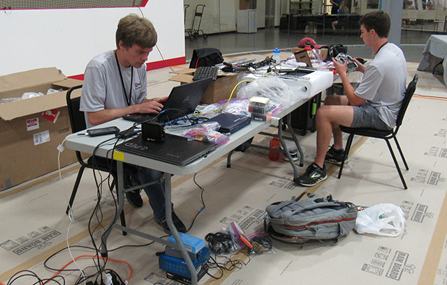 Teammates Robert Anderson and Matthew Giles, S.B. '21, work quickly to make repairs to their Mars Rover during the competition. (Photo courtesy of the Harvard Undergraduate Robotics Club)