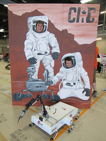 Giles and Anderson are ready for a simulated space adventure. (Photo courtesy of the Harvard Undergraduate Robotics Club)