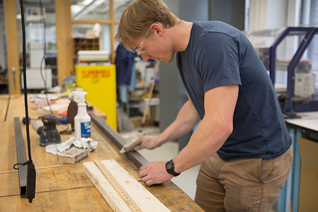 Sam Meijer, S.B. '19, a mechanical engineering concentrator, works on his team's prototype in the Active Learning Labs. (Photo by Adam Zewe/SEAS Communications)