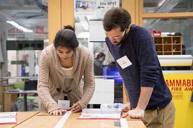Martina Pillay and teammate Kyle Dumont take careful measurements in the Active Learning Labs wood shop. (Photo by Eliza Grinnell/SEAS Communications)